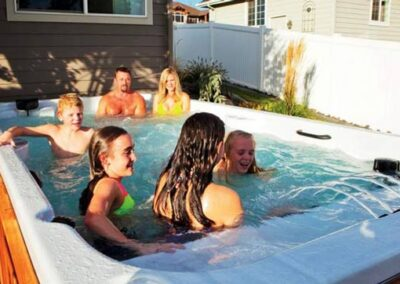 Family having fun in the hot tub